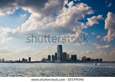 New Jersey city skyline under blue cloudy sky - stock photo