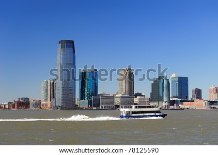 New Jersey Hoboken skyline panorama over Hudson River with skyscrapers and blue clear sky viewed from New York City Manhattan downtown. - stock photo