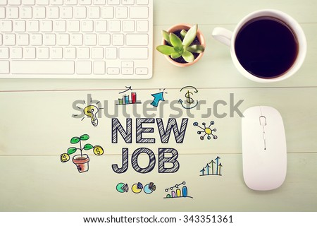 New Job concept with workstation on a light green wooden desk - stock photo