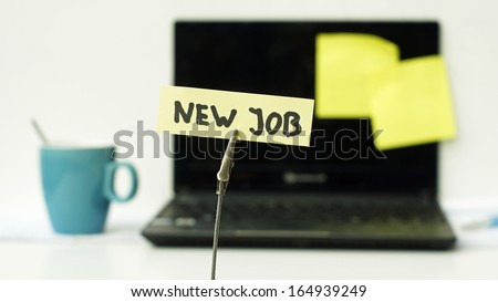 New job written on a memo in a office - stock photo