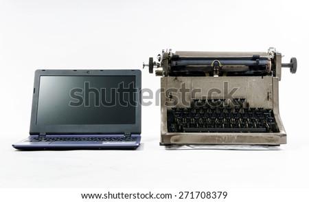 New laptop computer vs old vintage typewriter, isolated on white background - stock photo