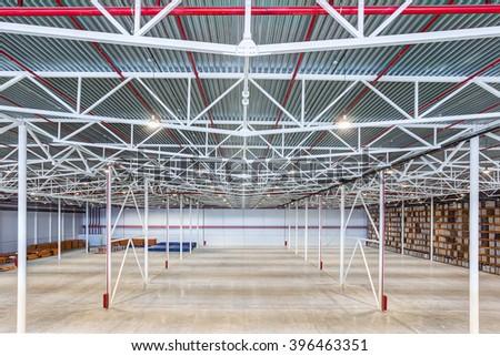 New Large modern empty warehouse  - stock photo
