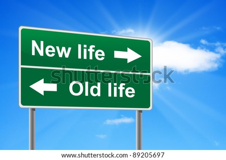 New life old life road sign on background clouds and sunburst. - stock photo