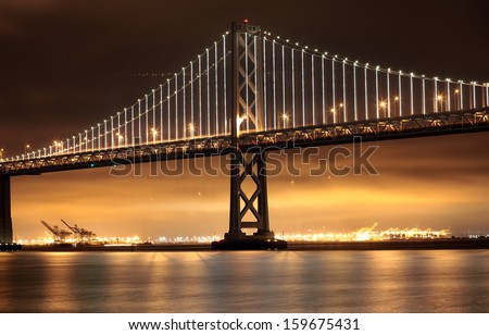 New lights illuminate the Bay Bridge connecting San Francisco and Oakland over San Francisco Bay in California. - stock photo