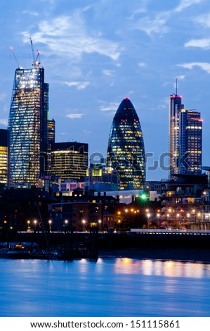 "New London Skyline 2013 with skyscrapers of The City including 122 Leadenhall Street ""The Cheesegrater"" (L) and 30 St Mary Axe ""The Gherkin"" (R) - stock photo"