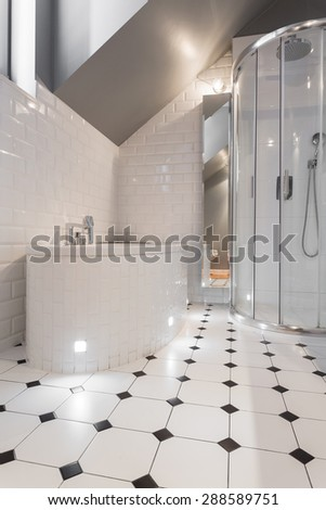 New luxury bathroom with white and black tiles - stock photo