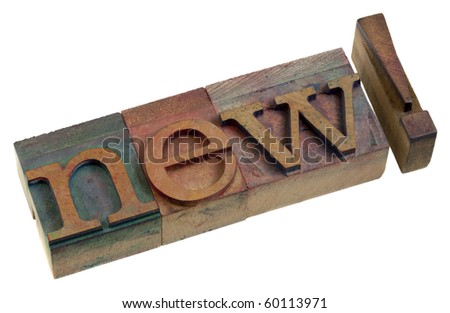 new, message or alert - a word in vintage wooden letterpress printing blocks - stock photo