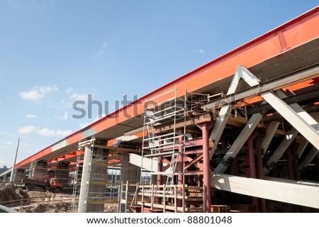 New metal bridge construction site. - stock photo