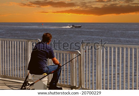 New metal fishing pier at sunset in Cedar Key, Florida - stock photo