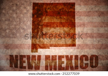 new mexico map on a vintage american flag background - stock photo