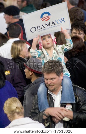"NEW MEXICO - OCTOBER 25: An unidentified child holds an ""Obama '08"" sign while attending an Obama presidential rally at the University of New Mexico on October 25, 2008 in Albuquerque, New Mexico. - stock photo"