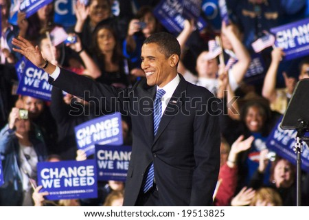NEW MEXICO - OCTOBER 25: U.S. Presidential candidate, Barack Obama, gestures as he greets supporters at his presidential rally at the University of New Mexico on October 25, 2008 in Albuquerque, New Mexico. - stock photo