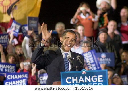 NEW MEXICO - OCTOBER 25: U.S. Presidential candidate, Barack Obama, gestures as he speaks at his presidential rally at the University of New Mexico on October 25, 2008 in Albuquerque, New Mexico. - stock photo
