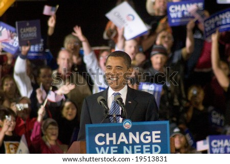 NEW MEXICO - OCTOBER 25: U.S. Presidential candidate, Barack Obama, smiles as he speaks at his presidential rally at the University of New Mexico on October 25, 2008 in Albuquerque, New Mexico. - stock photo
