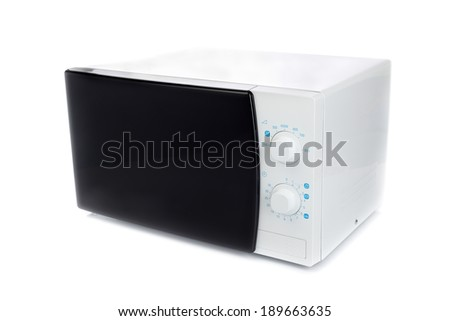 New microwave oven with analog control. Isolate on white - stock photo