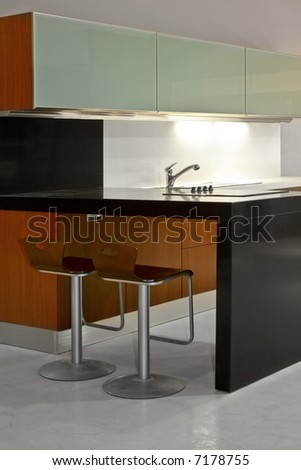 New minimalism kitchen appliances with bag chairs - stock photo