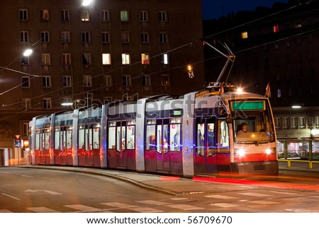 New model of Viennese tramway carrying it's passengers through Vienna - stock photo
