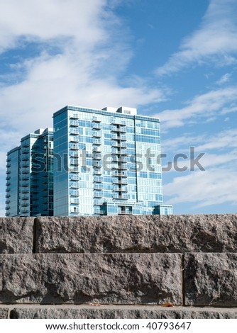 New modern apartments, with stone steps on the foreground - stock photo