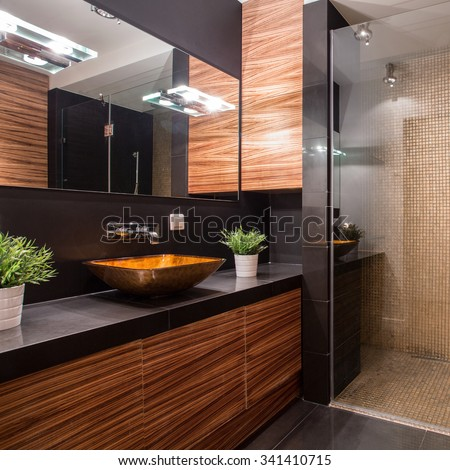 New modern bathroom with fancy shower on the wall - stock photo