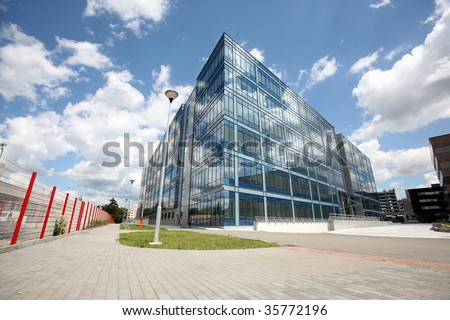 New modern futuristic building and blue skyes in cloudy day - stock photo