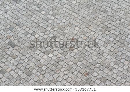 New modern gray cobblestone pavement texture as background - stock photo
