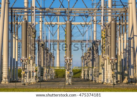 New Modern high-voltage Power substation with voltage transformers on blue sky background