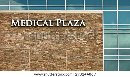New Modern Hospital with Medical Plaza Sign - stock photo