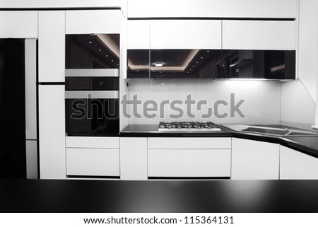New modern kitchen in black and white colors - stock photo