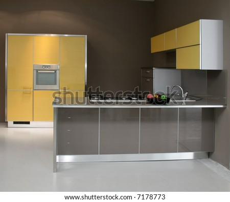 New modern kitchen in yellow with metal - stock photo