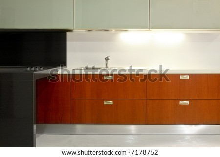New modern kitchen with metal and glass - stock photo