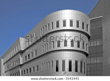 New modern office building with aluminum facade - stock photo