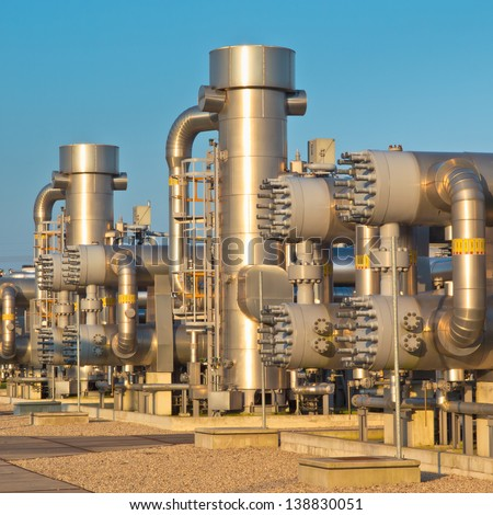 New Modern Oil and Gas Processing Plant during Sunset - stock photo