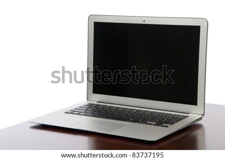 New Modern popular laptop thin computer, light weight with clipping path and black screen isolated on a white background