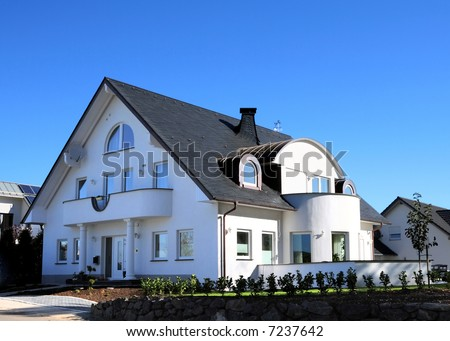 New modern white house and blue sky - stock photo