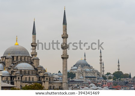 New Mosque and Suleymaniye Mosque in Istanbul on a cloudy day - stock photo