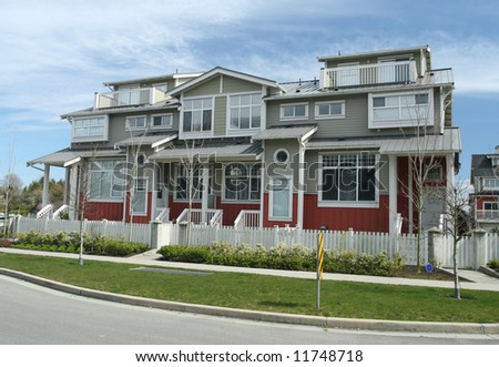 New Multi-Family Home With White Picket Fence - stock photo
