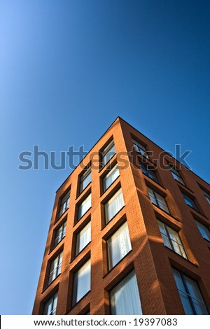New office building with blue sky. Vertical background.