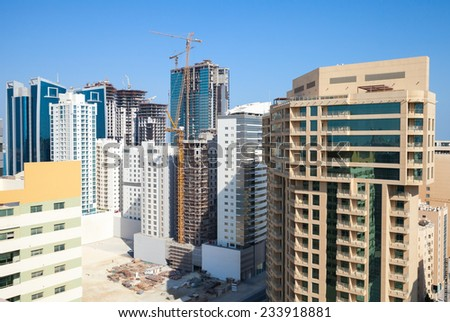 New office buildings and hotels are under construction in the city of Manama, Bahrain - stock photo