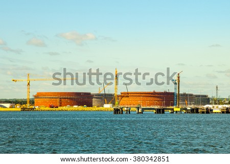New oil storage tanks under construction in port of Gdansk, Poland. - stock photo