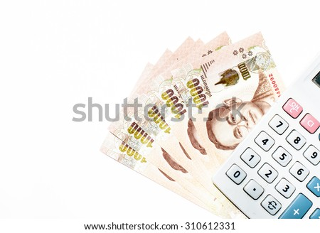 New one thousand banknotes of Thai currency,money with calculator on white background - stock photo