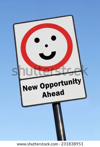 New Opportunity Ahead written on a road sign with a smiling face against a clear blue sky background - stock photo