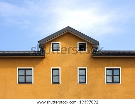 New orange building and blue sky background - stock photo