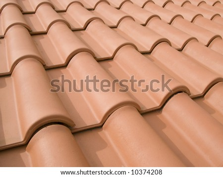 New orange roof tiles close up detail - stock photo