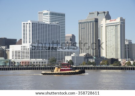 NEW ORLEANS AND THE MISSISSIPPI RIVER USA - CIRCA 2014 - The waterfront buildings of New Orleans city centre overlooking  the Mississippi River Louisiana USA - stock photo