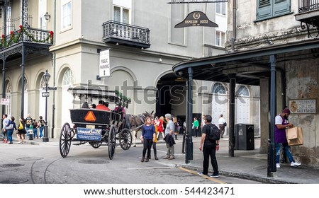 NEW ORLEANS - Dec. 24, 2016: French Quarter horse and carriage ride carries passengers through the neighborhood streets. Popular tourist activity in the historic district.