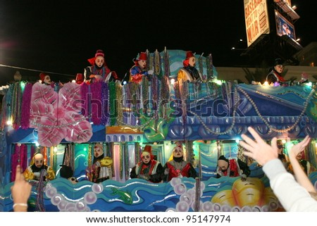 NEW ORLEANS - FEBRUARY 2: People celebrated crazily in Mardi Gras parade. February 2, 2008 in New Orleans, Louisiana. - stock photo