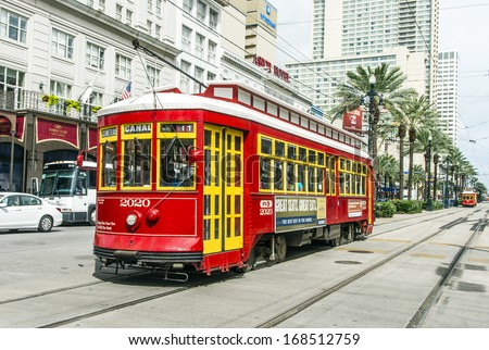 NEW ORLEANS - JULY 16: people travel with the Street car Canal street line St. Charles line on July 16, 2013 in New Orleans, USA.  It is the oldest continually operating street car line in the world. - stock photo