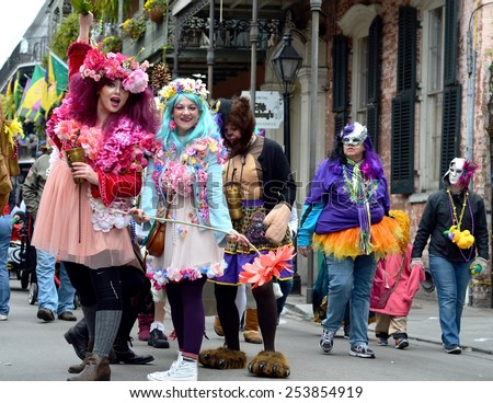 NEW ORLEANS, LA.-FEBRUARY 17:  Party people in costumes and masks parade through the streets of the New Orleans French Quarter on Mardi Gras Day, Tuesday, February 17, 2015.  - stock photo