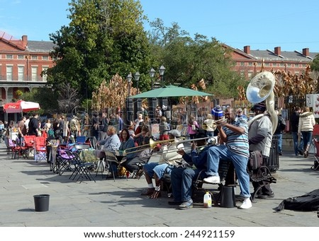 NEW ORLEANS, LA-JAN. 17: A local jazz band performs in front of Jackson Square in the New Orleans French Quarter on January 17, 2015, to the delight of visitors in town for Mardi Gras. - stock photo