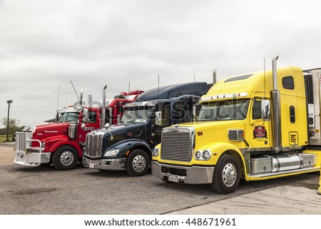 NEW ORLEANS, LA, USA - APR 17, 2016: Freightliner, Peterbilt and Western Star trucks at the parking lot in Louisiana, United States